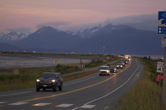 Cars evacuate the Homer Spit in Alaska after tsunami warning