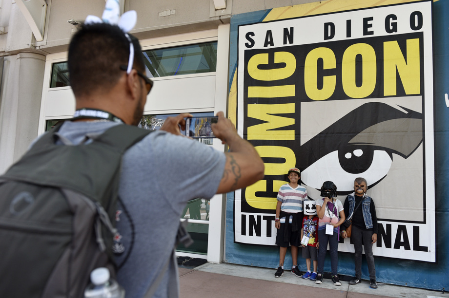 Luis Ramos, left, of San Diego takes a picture of his son, daughter, and their friends
