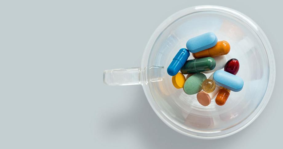 Cupful of pills, medicines.