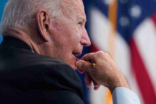 President Joe Biden listens during a virtual meeting with FEMA Administrator Deanne Criswell and governors and mayors of areas impacted by Hurricane Ida, in the South Court Auditorium on the White House campus, Monday, Aug. 30, 2021, in Washington.