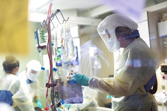 """In this Aug. 31, 2021, file photo, Jack Kingsley R.N. attends to a COVID-19 patient in the Medical Intensive care unit (MICU) at St. Luke's Boise Medical Center in Boise, Idaho. Idaho public health leaders have activated """"crisis standards of care"""" for the state's northern hospitals because there are more coronavirus patients than the institutions can handle. The Idaho Department of Health and Welfare made the announcement Tuesday, Sept. 7."""