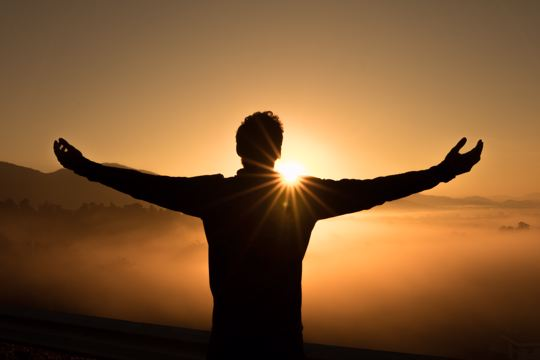 man worshipping with open arms
