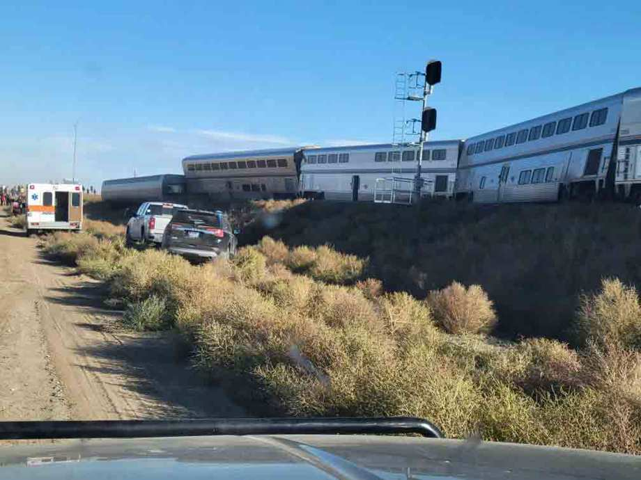 In this photo provided by Kimberly Fossen an ambulance is parked at the scene of an Amtrak train derailment on Saturday, Sept. 25, 2021, in north-central Montana.
