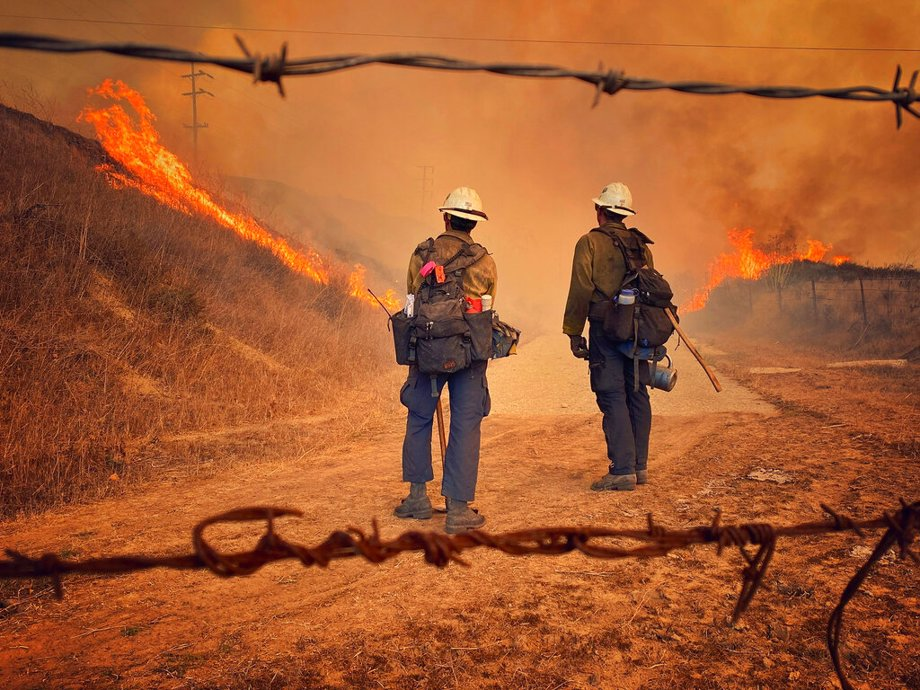 Santa Barbara County Fire Hand Crew members fight fire with fire and burn off pockets of grass along northbound Highway 101 north of Arroyo Hondo Canyon