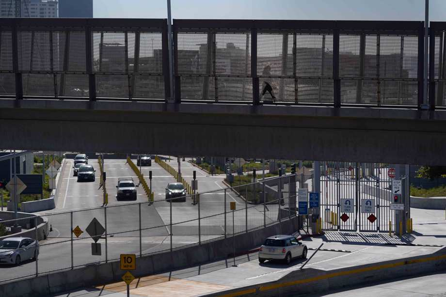 A few cars make their way north to cross into the United States from Tijuana, Mexico, Wednesday, Oct. 13, 2021, at the San Ysidro Port of Entry in San Diego.