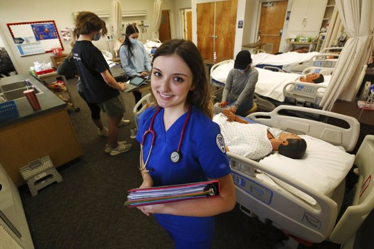 First year nursing student, Emma Champlin, in her clinical laboratory class at Fresno State