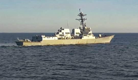 Taken from video released by Russian Defense Ministry Press Service, the U.S. destroyer USS Chafee is seen form Russian navy's Admiral Tributs destroyer near Russian territorial waters in the Sea of Japan