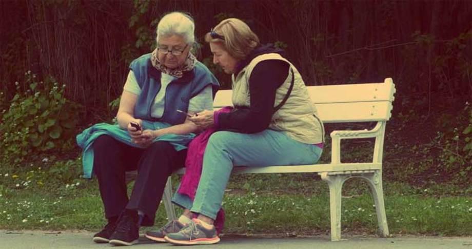 Senior Citizens Using Phone