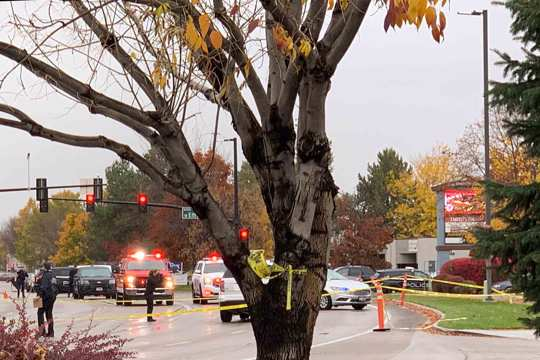 Police close off a street outside a shopping mall after a shooting in Boise, Idaho on Monday, Oct. 25, 2021. Police said there are reports of multiple injuries and one person is in custody.
