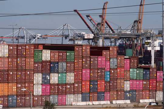 Cargo containers sit stacked at the Port of Los Angeles in San Pedro, Calif., Tuesday, Oct. 19, 2021.