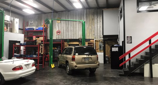 God's Garage repair shop with cars