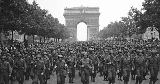 1944 US soldiers march in Paris after liberation of France