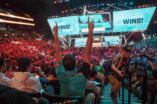 London Spitfire fan Rick Ybarra, of Plainfield, Ind., reacts after London won the second game against the Philadelphia Fusion during the Overwatch League Grand Finals competition at Barclays Center in New York