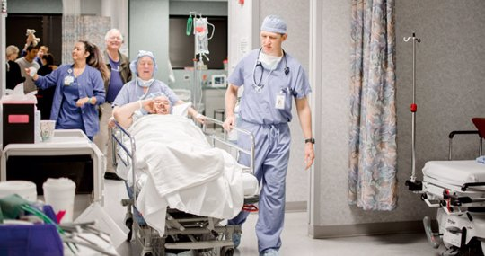 Patient on gurney getting wheeled into surgery