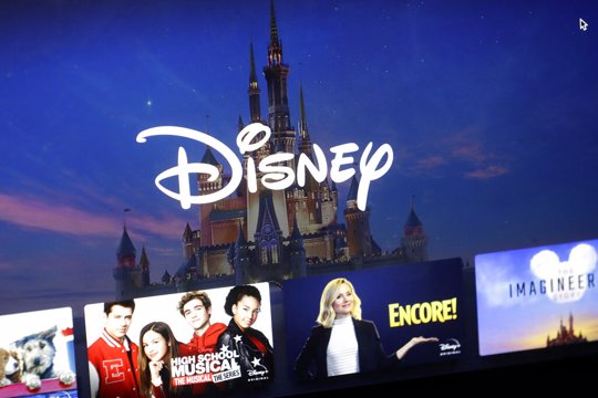 Disney logo forms part of a menu for the Disney Plus movie and entertainment streaming service on a computer screen