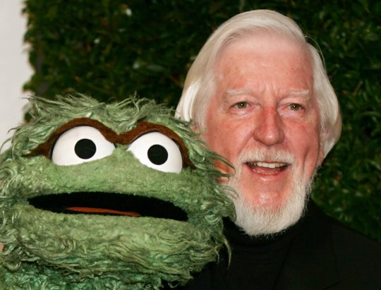 "Caroll Spinney, right, who portrays ""Sesame Street"" characters Oscar The Grouch, left, and Big Bird, arrives for the Daytime Emmy nominee party at the Hollywood Roosevelt Hotel in Los Angeles. Spinney, who gave Big Bird his warmth and Oscar the Grouch his growl for nearly 50 years on ""Sesame Street,"" died Sunday, Dec. 8, 2019, at the age of 85 at his home in Connecticut, according to the Sesame Workshop."
