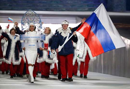 Russian athletes holding Russian flag