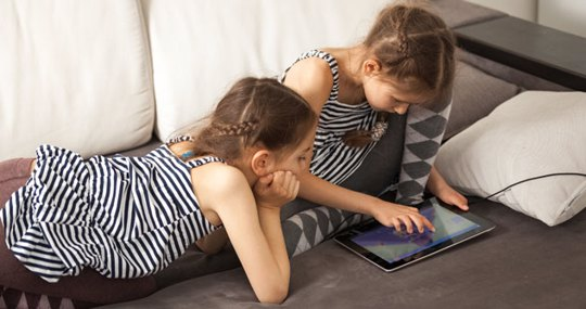 Two children on a tablet