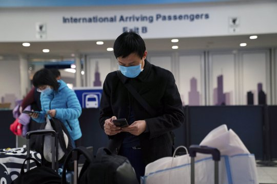 Passengers from United flight UA850 direct from Beijing arrive at Terminal 5 at O'Hare International Airport, Friday, Jan. 24, 2020 in Chicago. A Chicago woman has become the second U.S. patient diagnosed with the dangerous new virus from China, health officials announced Friday.
