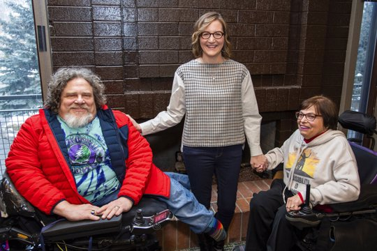 """Co-directors Jim LeBrecht, left, and Nicole Newnham join one of the subjects, Judith Heumann, from the documentary """"Crip Camp"""" to pose for a portrait during the 2020 Sundance Film Festival on Friday, Jan. 24, 2020, in Park City, Utah."""