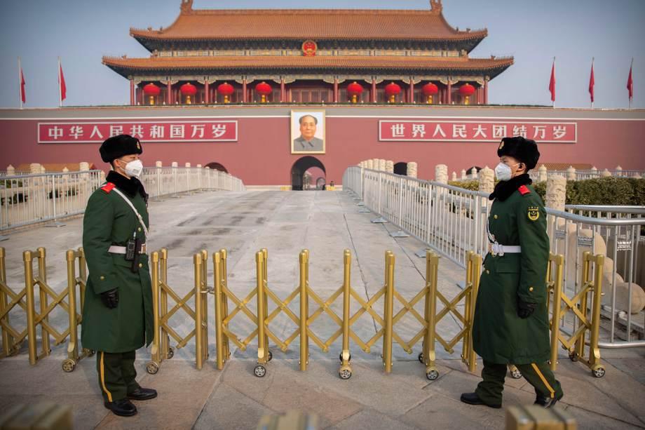 Paramilitary police stand guard at Tiananmen Gate