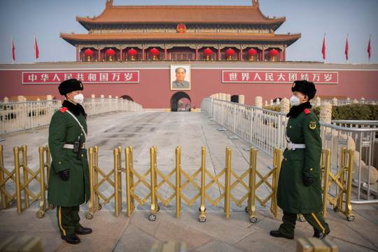 Paramilitary police stand guard at Tiananmen Gate