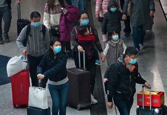 Travelers at Hong Kong Airport