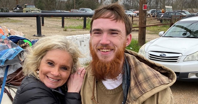 Teresa smiling next to a man with a beard