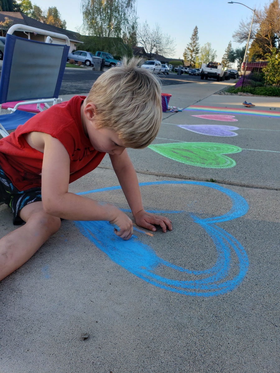 Jesse, doing chalk art