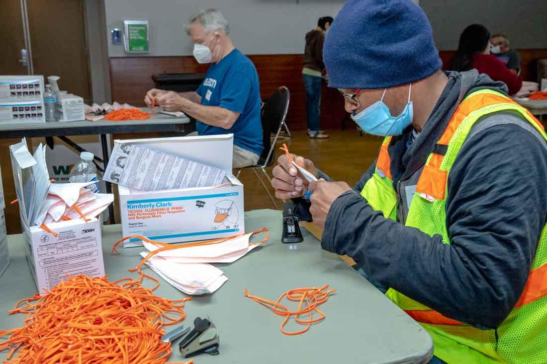 Volunteers repairing N95 masks