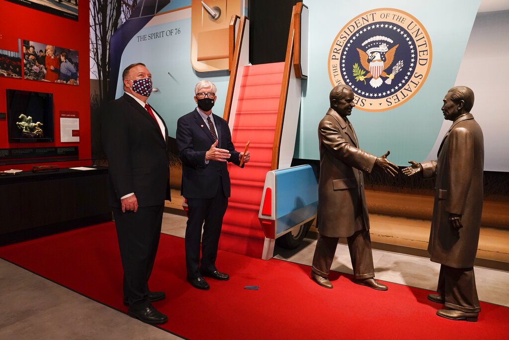 Secretary of State Mike Pompeo, left, tours the Richard Nixon Presidential Library with Hugh Hewitt, president and CEO of the Nixon Foundation