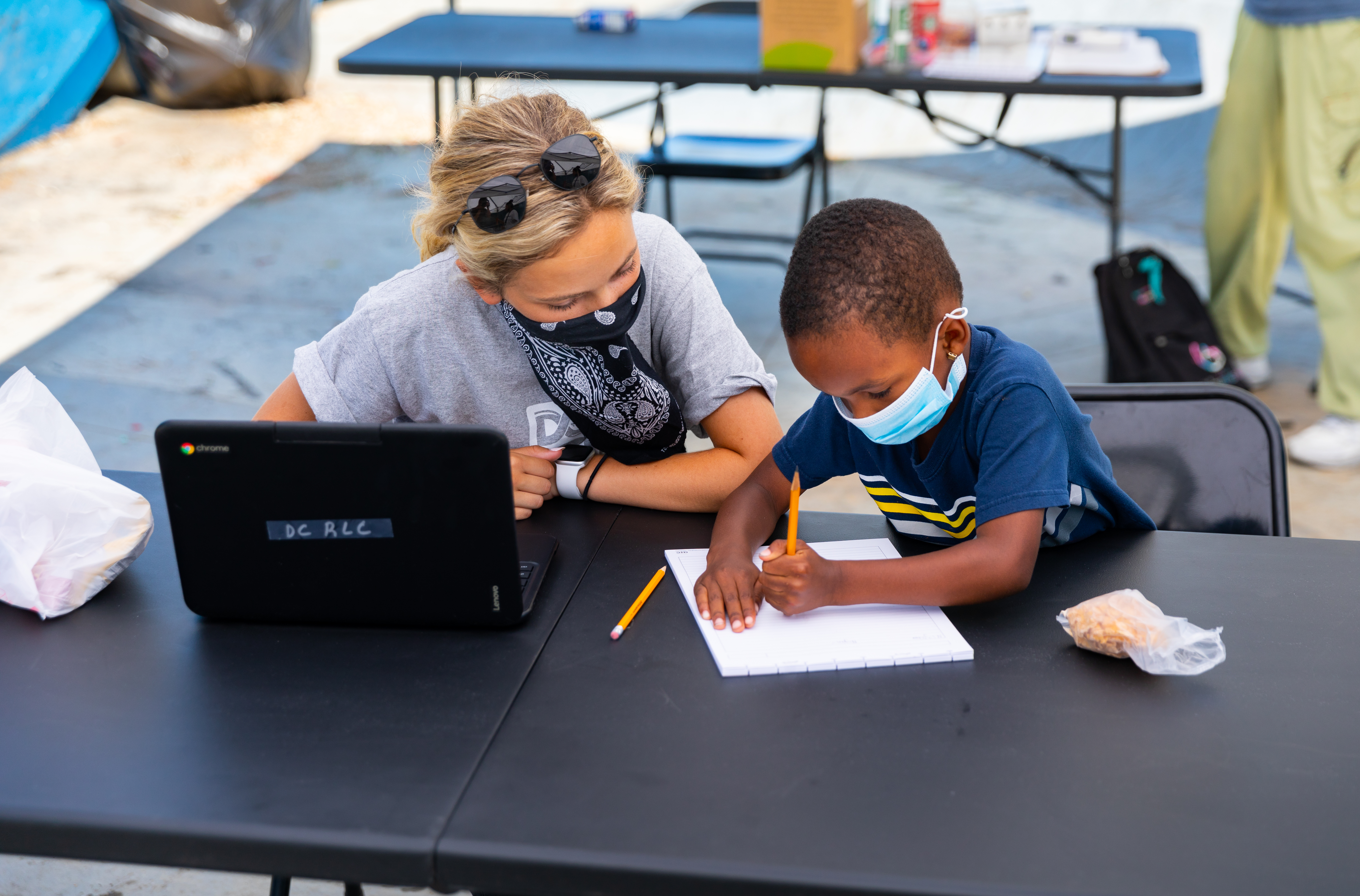 Child getting school help at the Dream Center