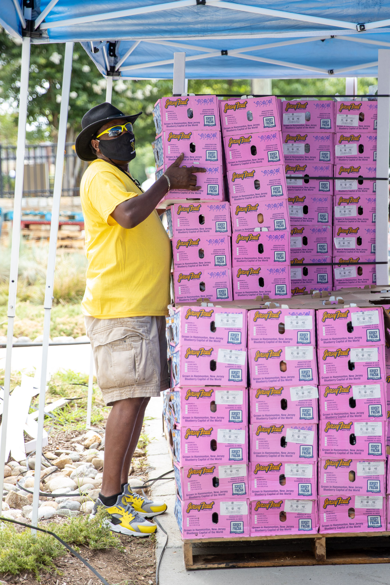 Person stacking produce boxes