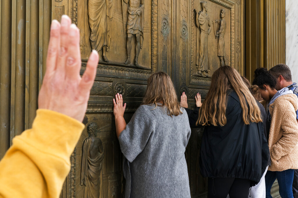 People pray to Jesus at the door of the Supreme Court in support of Supreme Court nominee Amy Coney Barrett