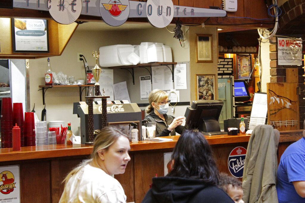 Restaurant co-owner Liz Mitchell works behind the counter at the Carver Hangar in Boring, Ore.