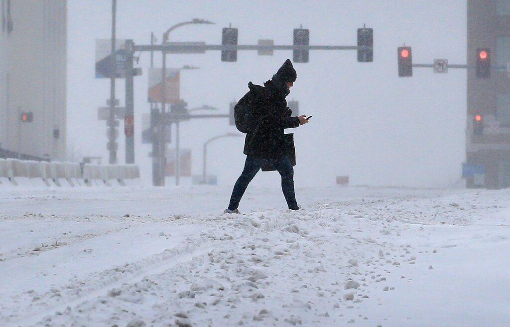 Pedestrian crosses street in St. Louis