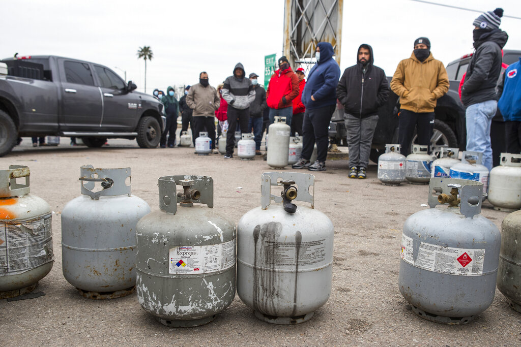 People line up to fill their empty propane tanks in Houston. Temperatures stayed below freezing Tuesday, and many residents were without electricity.