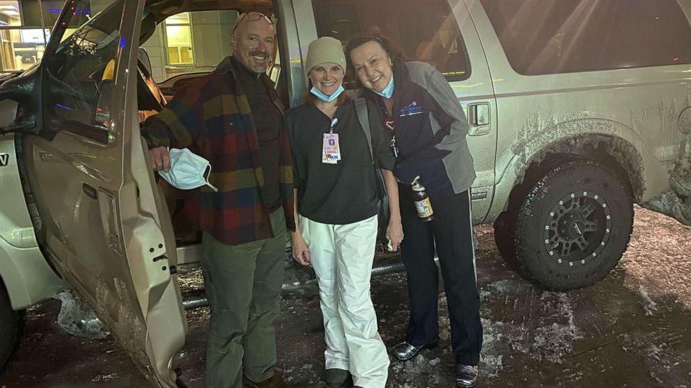 doctor and nurses outside car