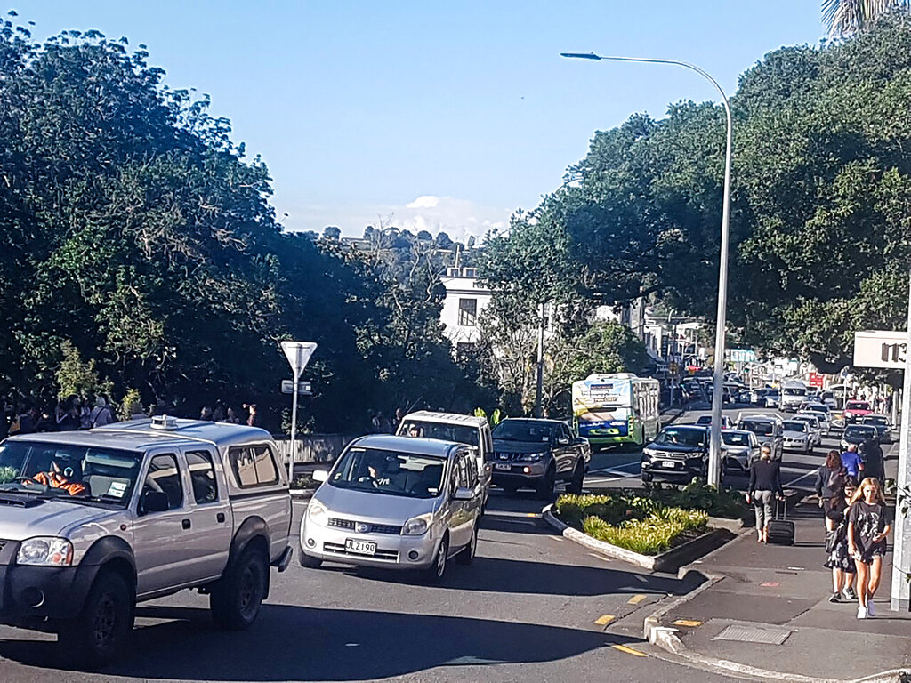Traffic slowly works up to high ground at Whangarei, New Zealand, as a tsunami warning is issued