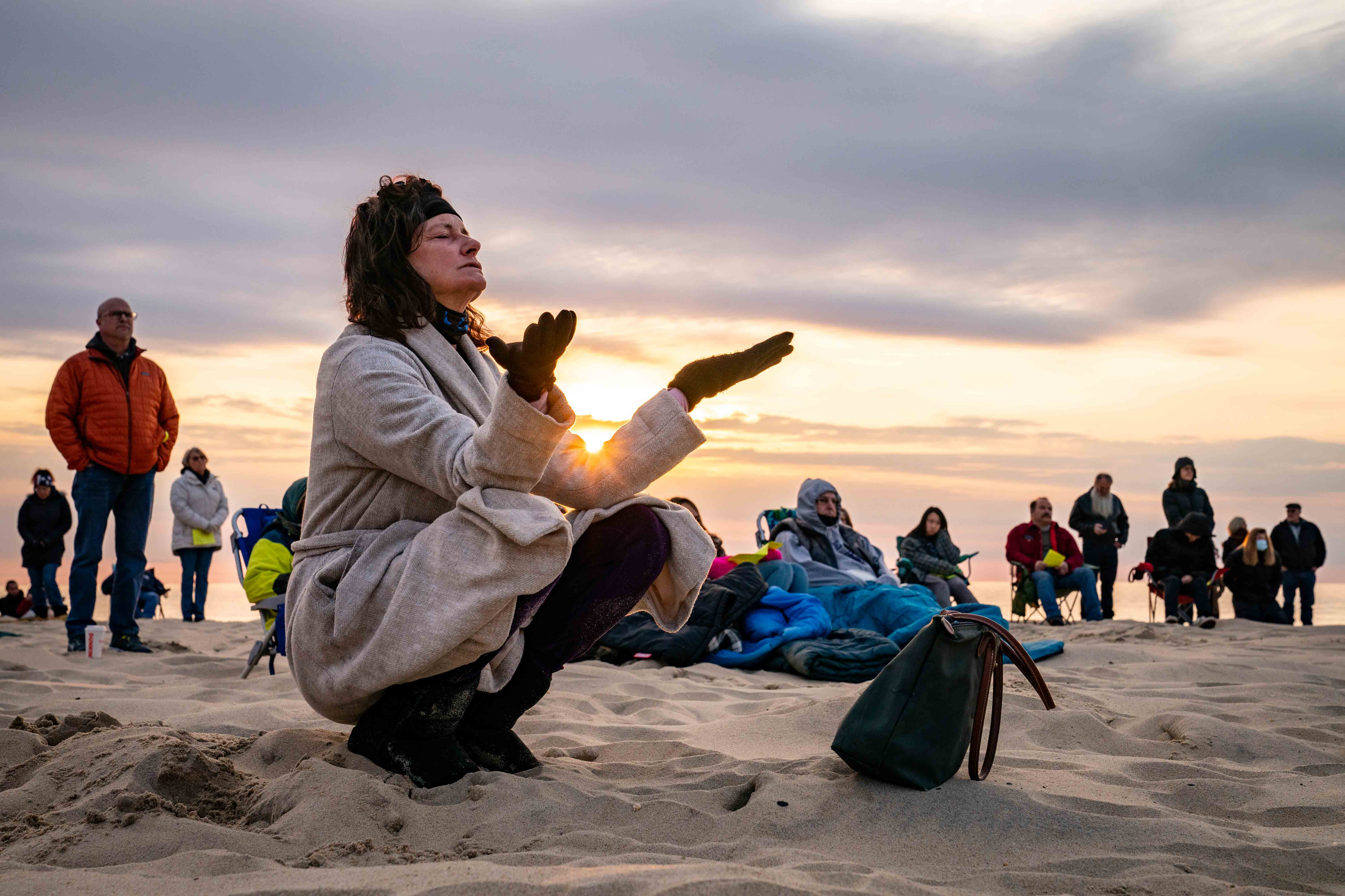 Parishioners gather on a beach for an Easter Sunday service at sunrise hosted by Hope Community Church of Manasquan, Sunday, April 4, 2021, in Manasquan, N.J.