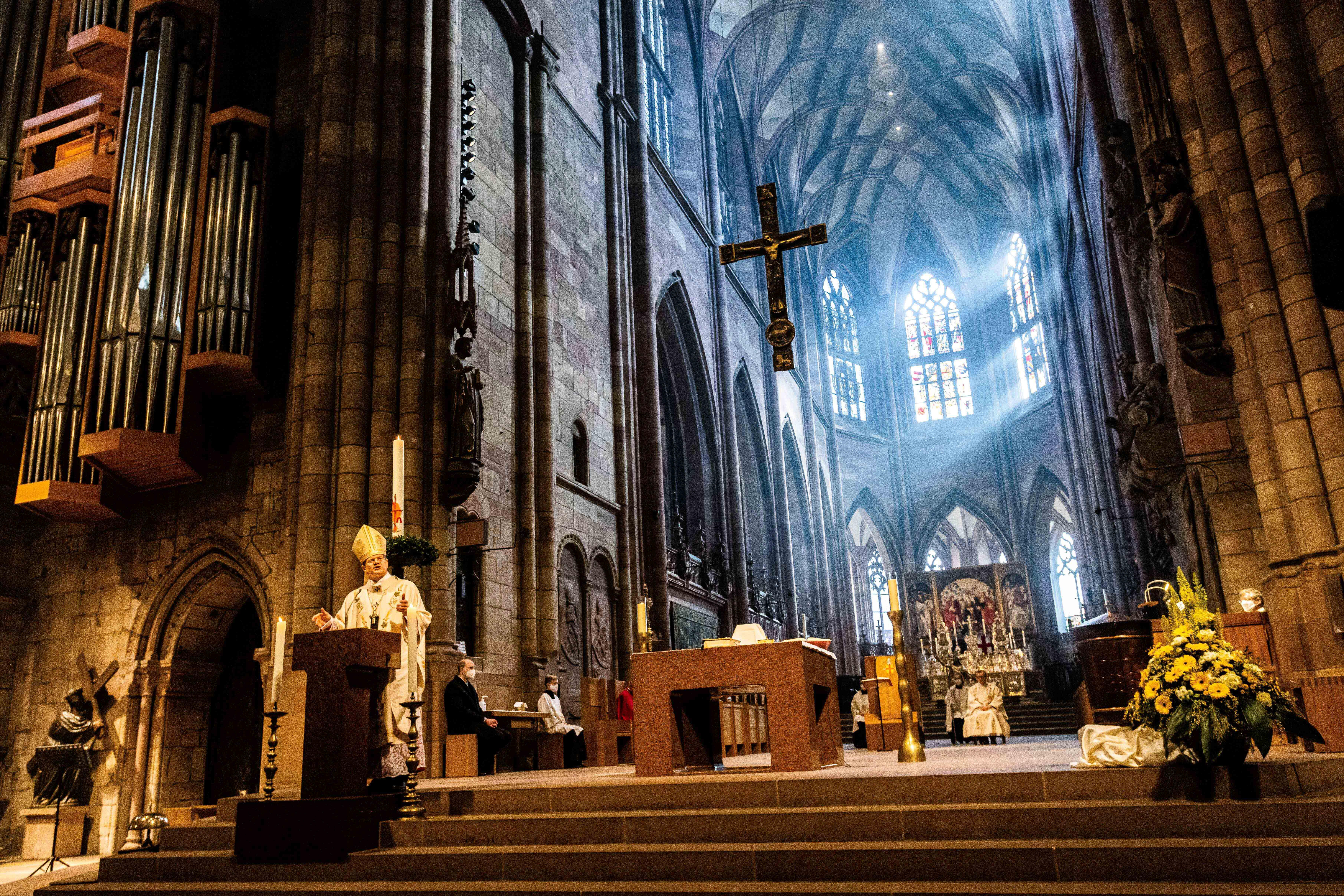 Archbishop Stephan Burger speaks to the faithful during the Pontifical Mass for Easter Sunday in Freiburg Cathedral in Freiburg, Germany, Sunday, April 4, 2021.