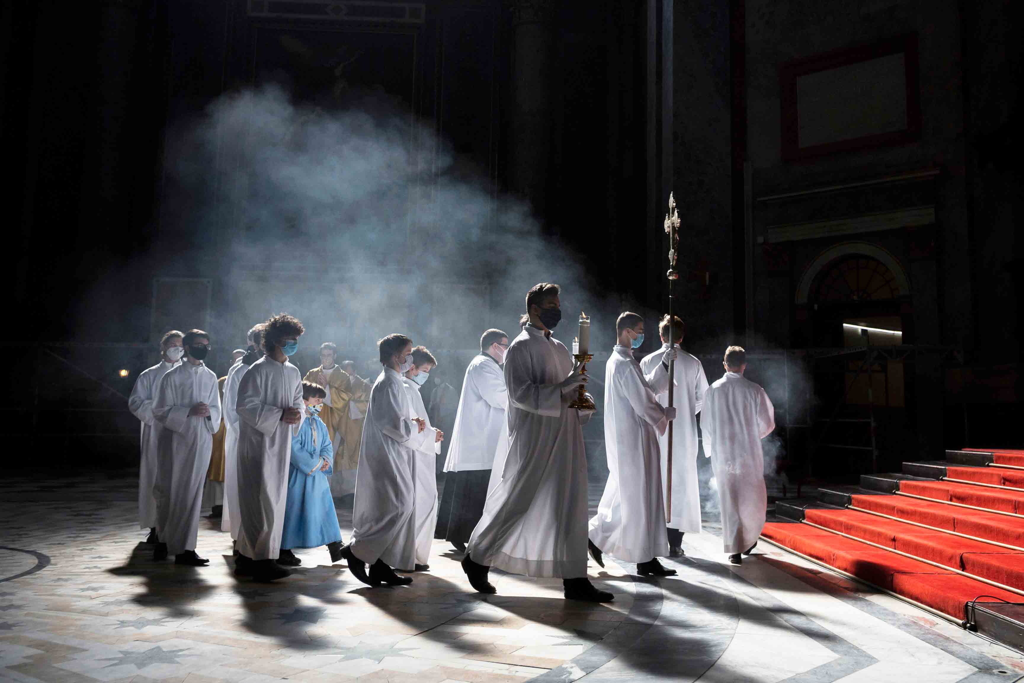 Clergyman and servers arrive for the Easter Sunday Mass celebrated by Primate of the Hungarian Catholic Church, Archbishop of Esztergom-Budapest, Cardinal Peter Erdo in the Esztergom Basilica in the City of Esztergom, Hungary, Sunday, April 4, 2021