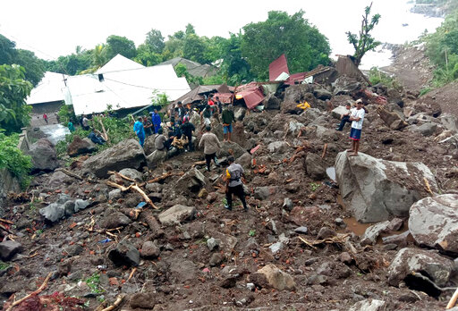 Rescuers search for victims at a village hit by a landslide in Ile Ape Timur on Lembata Island, East Nusa Tenggara province, Indonesia