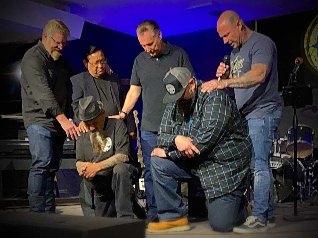 pastor praying for people