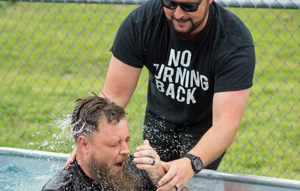 Pastor Jarod conducts outdoor water baptism