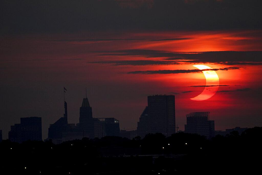 Solar Eclipse over Baltimore Skyline