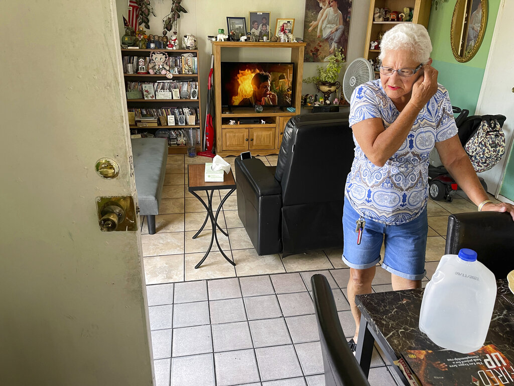 Carmen Millan, 82, uses a fan with open windows and door to keep cool at her apartment on East Desert Inn Road and South Athens Street in Las Vegas