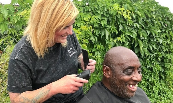Man getting haircut on street