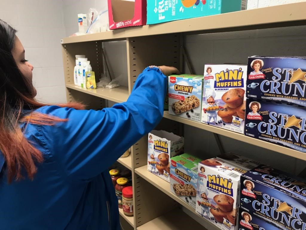 Person stocking student food pantry