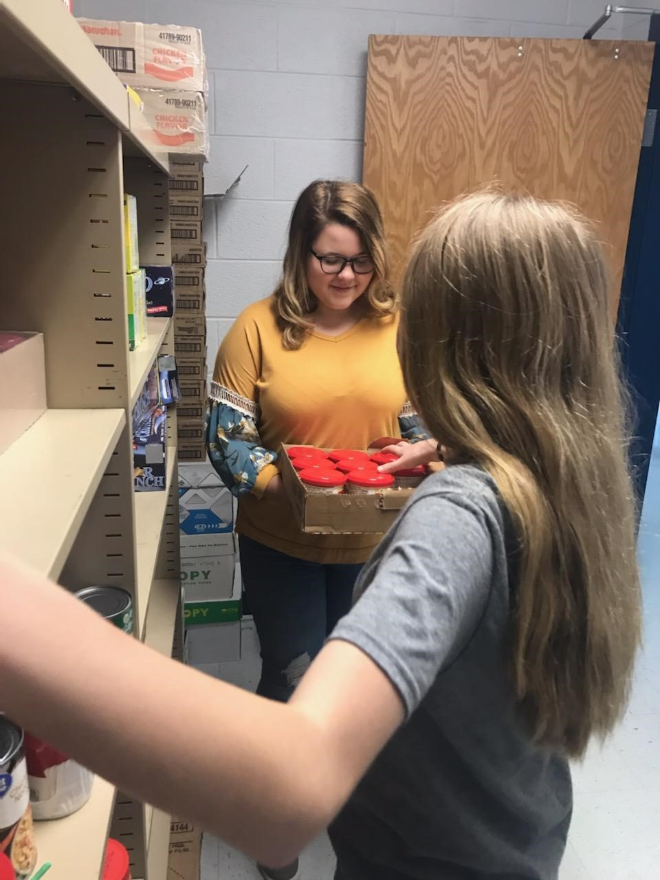 Students stocking school food pantry
